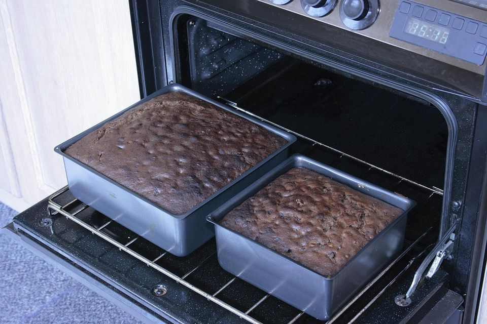Removing the wedding cakes from the oven