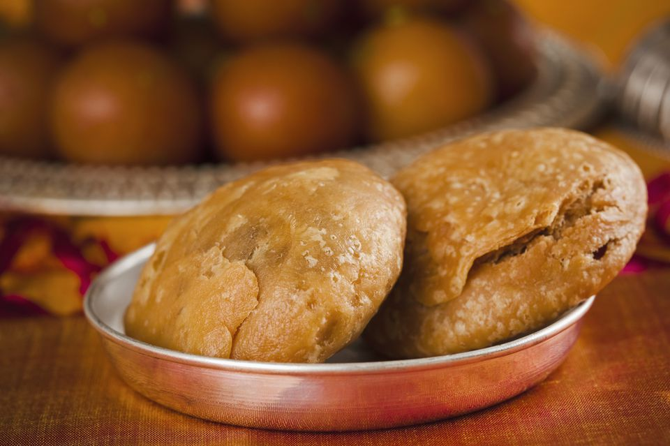 Close-up of two kachories (deep fried traditional Indian snack) in a bowl