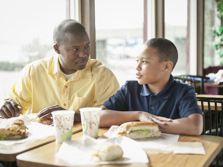 Father dining with son at fast food restaurant