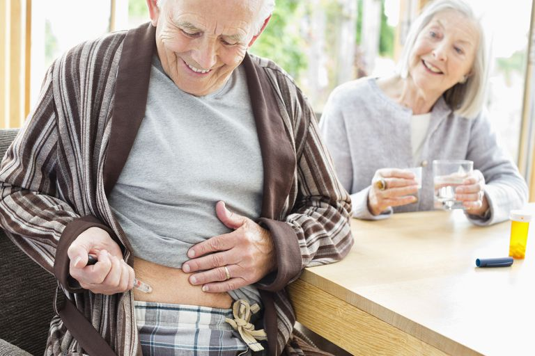 Older man giving himself injection