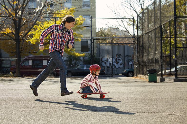 Father And Son Playing on Skateboard