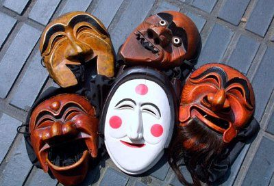 A heap of traditional Korean Hahoe masks, used for festivals and rituals.