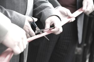 a businessman at a ribbon cutting ceremony