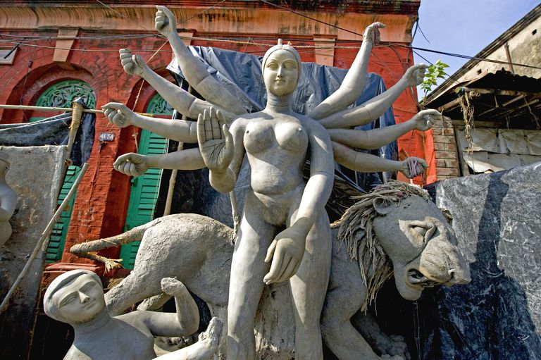 Clay model of goddess Durga with her consorts in process of complete, Calcutta, West Bengal, India