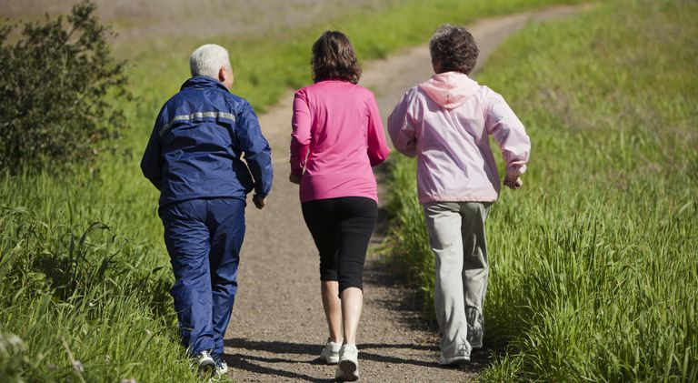 Senior Women Walking on Hill