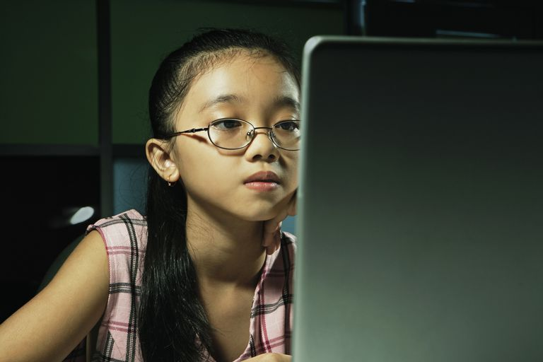Schoolgirl (10-12) using laptop computer, close-up