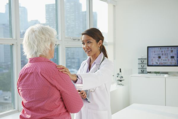 Female doctor delivering good news to patient