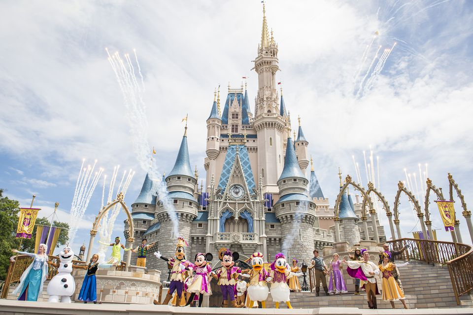 Characters in front of Cinderella Castle during Mickey's Royal Friendship Faire show