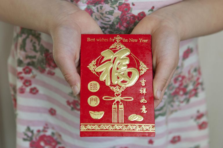 Child holding a Honbao red envelope