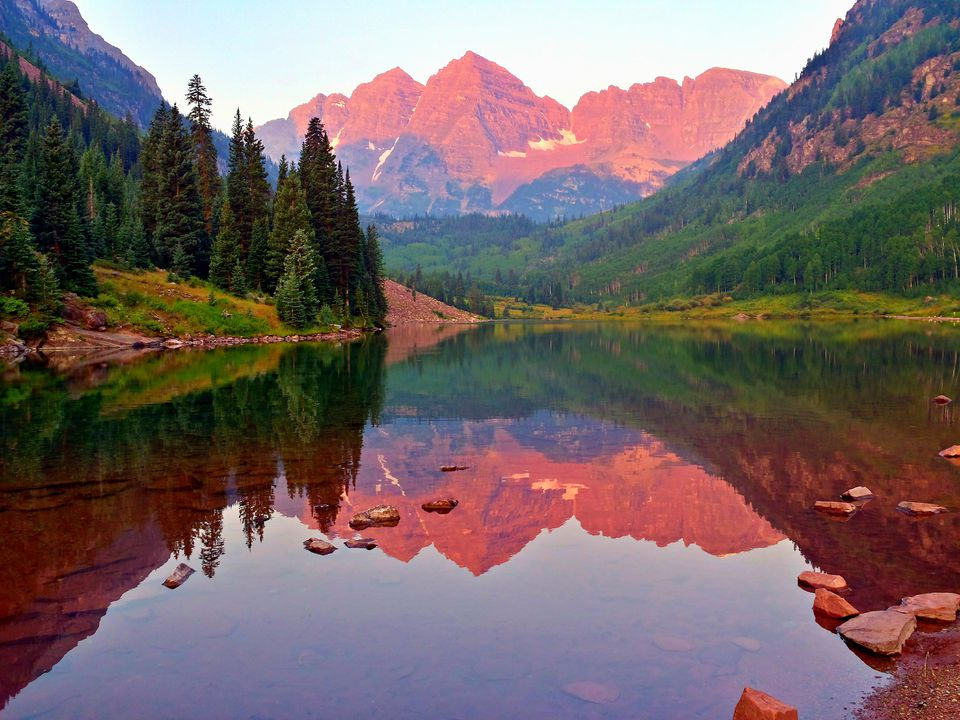 Idyllic View Of Maroon Bells By Calm Lake