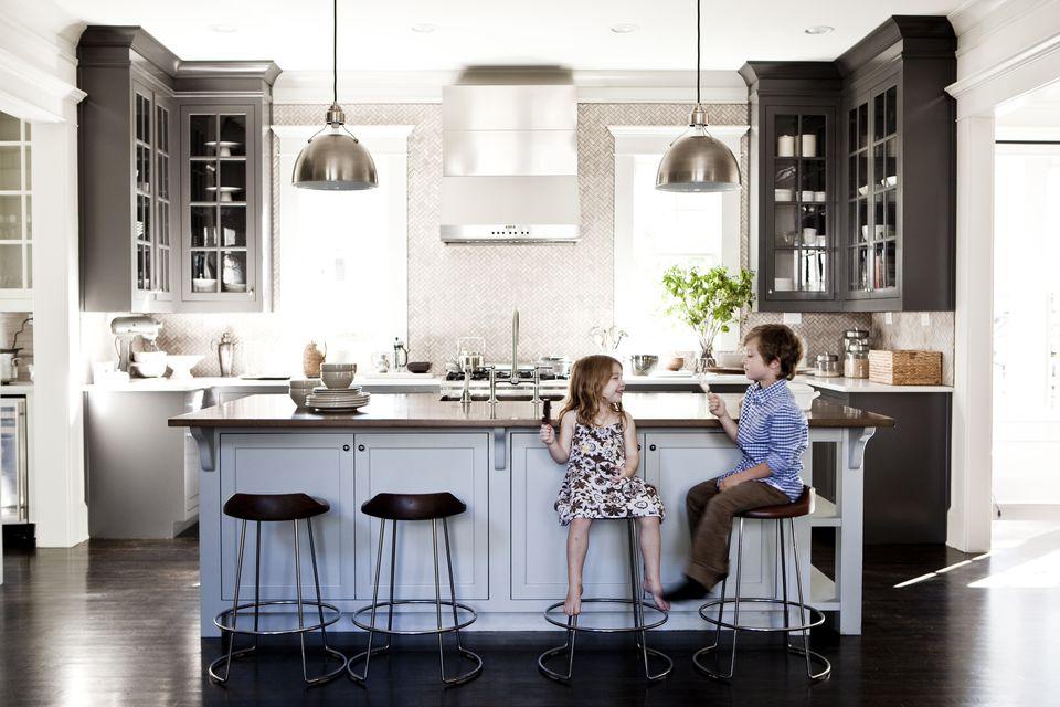 Children eating popsicles in kitchen