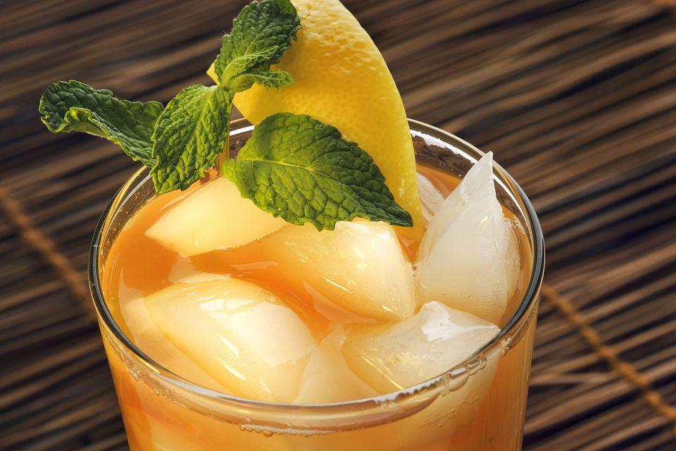 A glass of orange mint tea