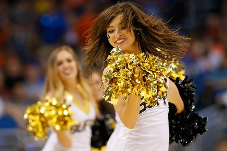 ORLANDO, FL - MARCH 20: A Colorado Buffaloes cheerleader performs in the second half while taking on the Pittsburgh Panthers during the second round of the 2014 NCAA Men's Basketball Tournament at Amway Center on March 20, 2014 in Orlando, Florida.