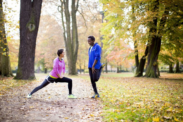 Couple stretching outside