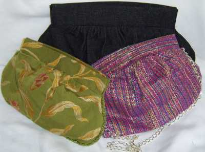 A photo of clutch purses sewn with the free sewing pattern.