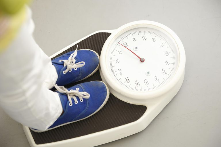 Child's feet on scales