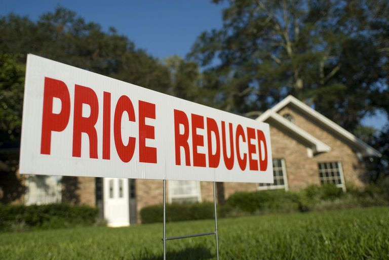 Price reduced real estate sign