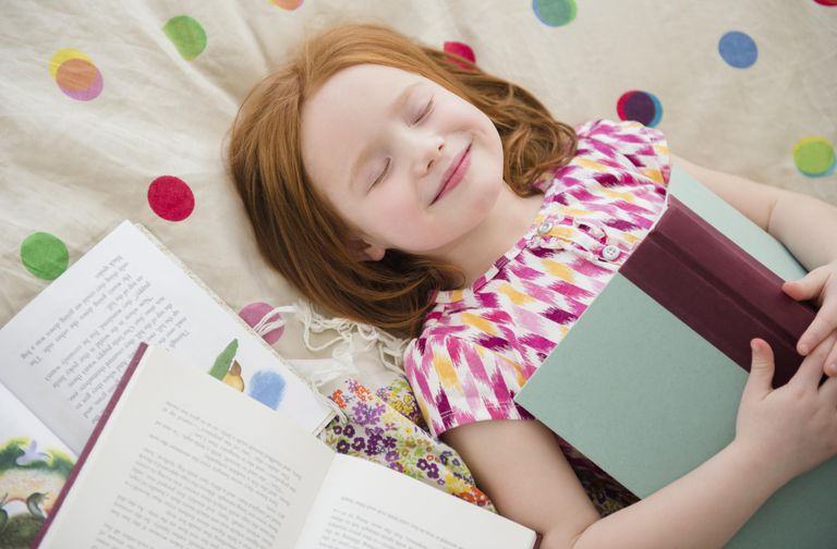 girl with book smiling