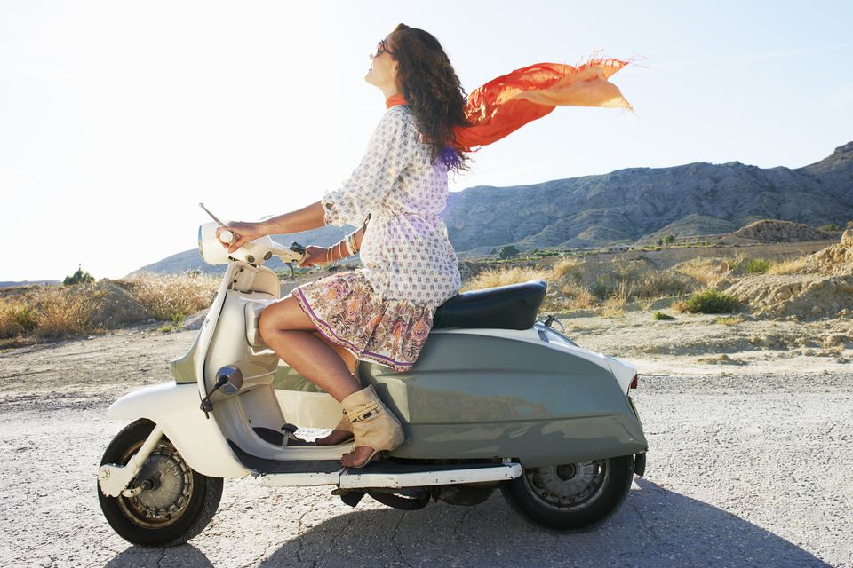 Woman with motorbike and sidecar