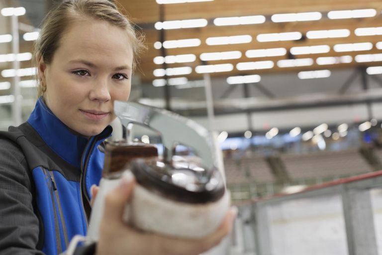 a young woman looking at an ice skate