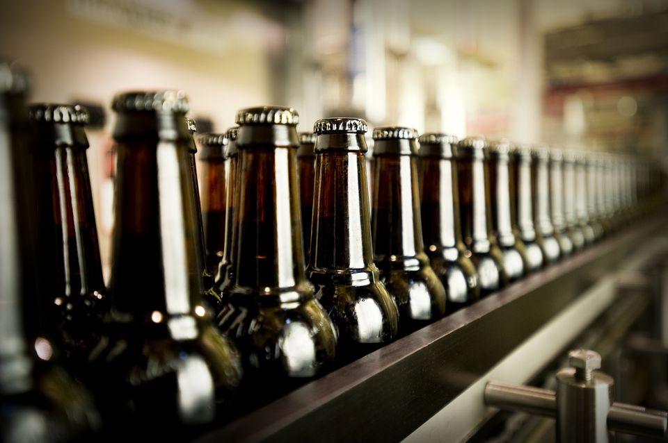 Capped beer bottles in the filling room