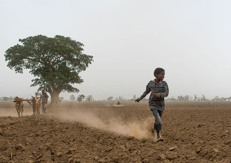 child running in dirt