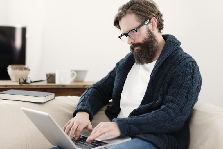 writer and editor career information man typing on laptop
