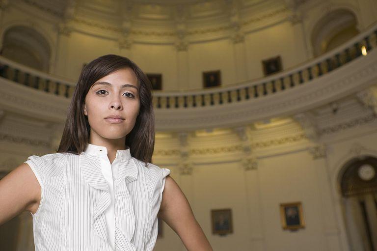 hispanic woman under US Capitol dome