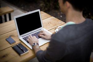 Man using computer at cafe