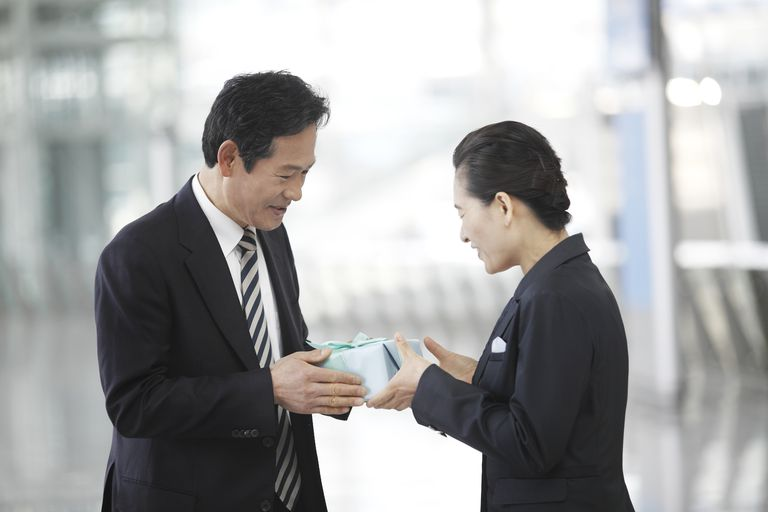Man giving woman a gift