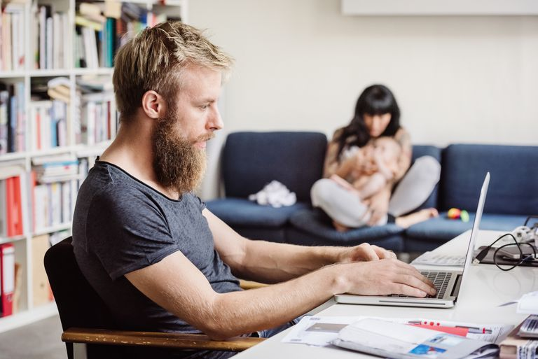 Young father on laptop at home