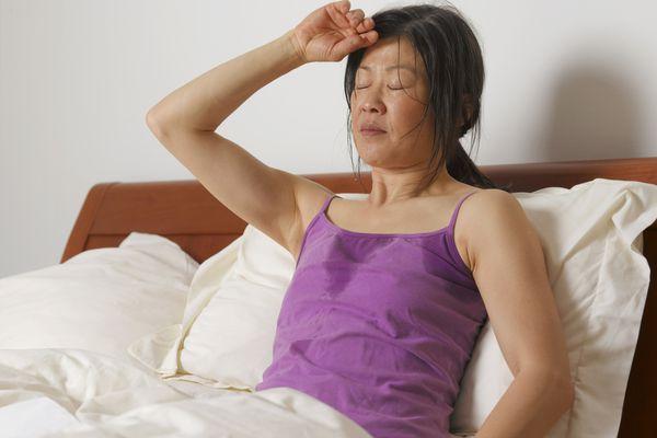 menopausal woman having night sweats