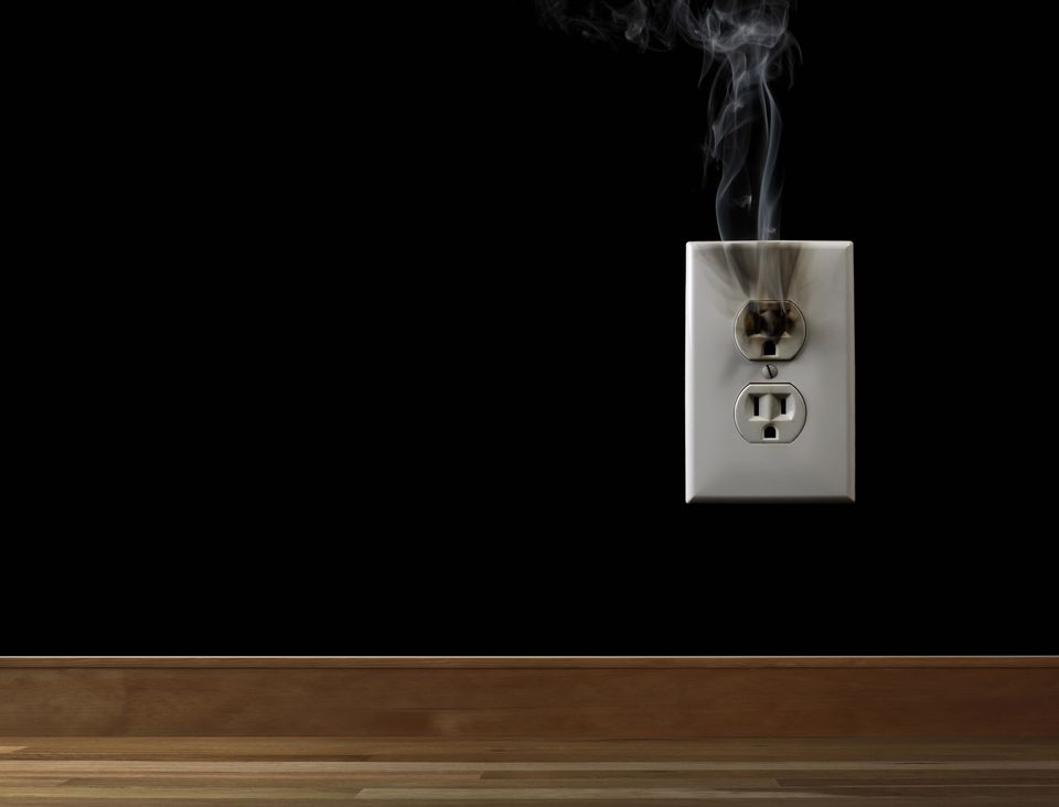 Smoke rising from electrical outlet