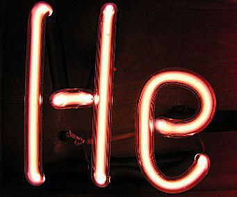 A helium filled discharge tube shaped like the element's atomic symbol.