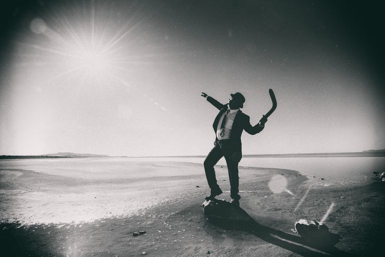 Businessman Tossing a Boomerang to the Sun