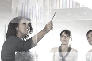 Woman in office talking about measuring metrics.