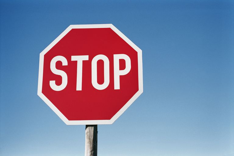 Photo of a stop sign against a blue sky
