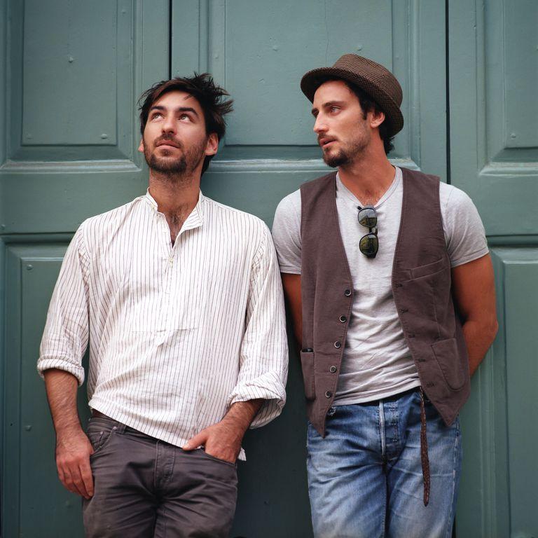Two Italian men in front of wooden door