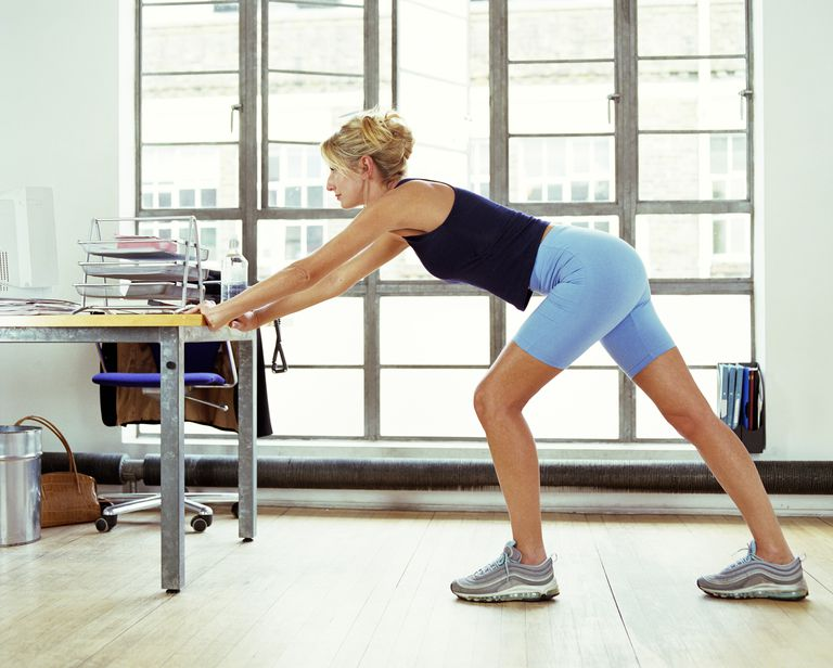 Woman stretching at the office