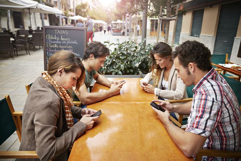 eating and using cellphones in Mallorca, Spain