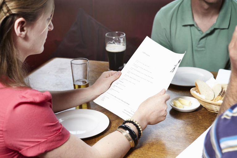 Woman reading bar menu