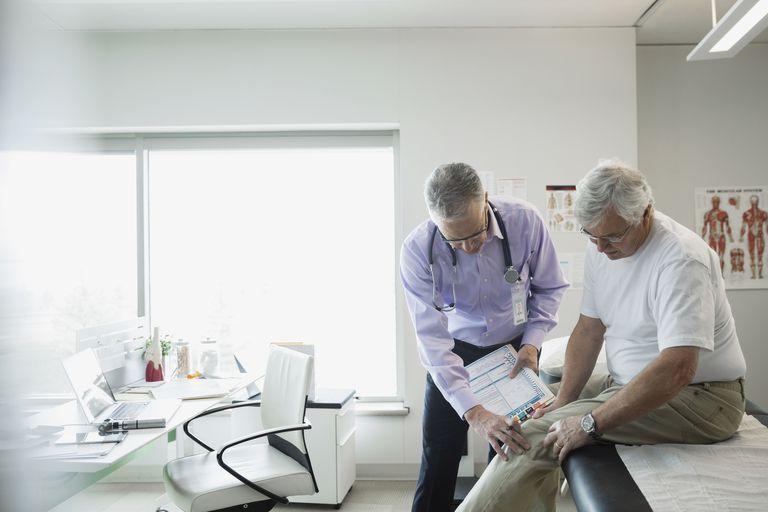 Doctor examining patient knee