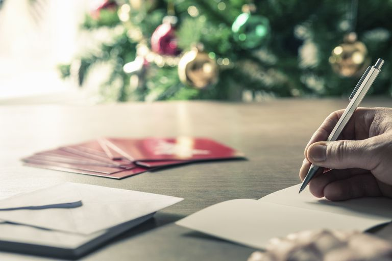 Person writing christmas cards
