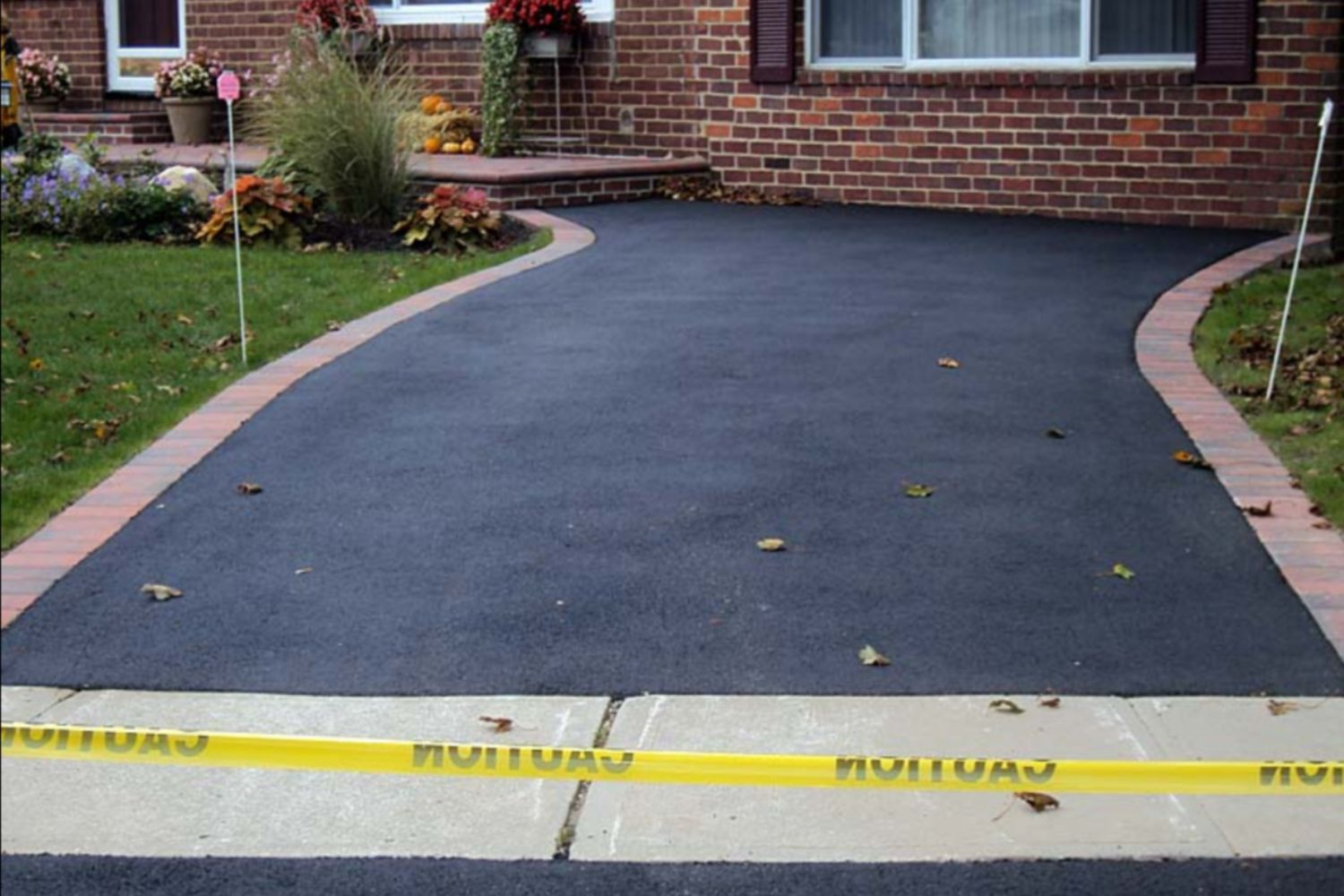 fence next to driveway. learn how asphalt paving can give you a new driveway on the cheap fence next to