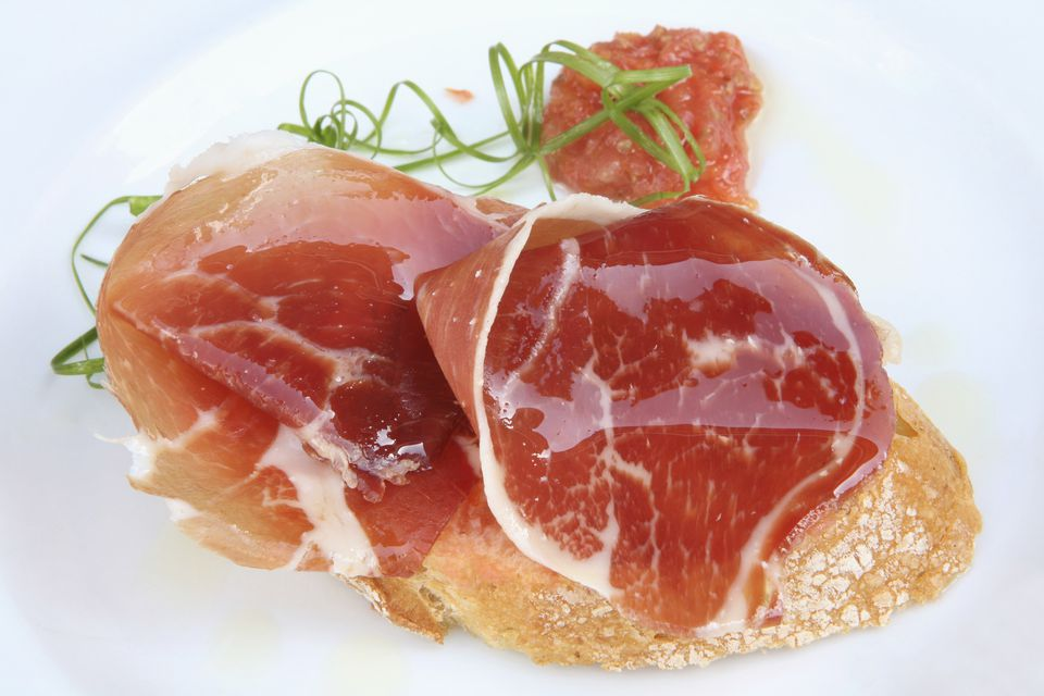 Ham tapas served on white plate,