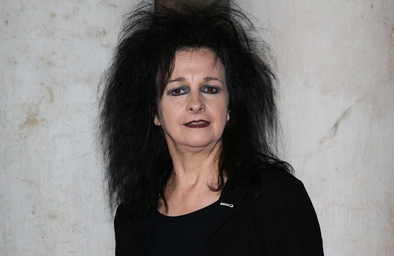 French female architect Odile Decq, April 2012, dark eye shadow, frizzed dark hair, red lipstick