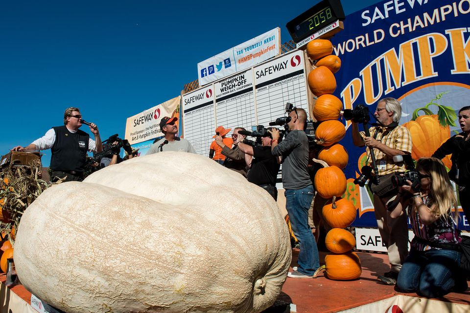 2014 World Championship Pumpkin Weigh-Off winner John Hawkley with his 2,058 lb Atlantic Giant