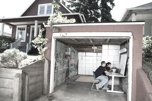 Couple operating business in garage