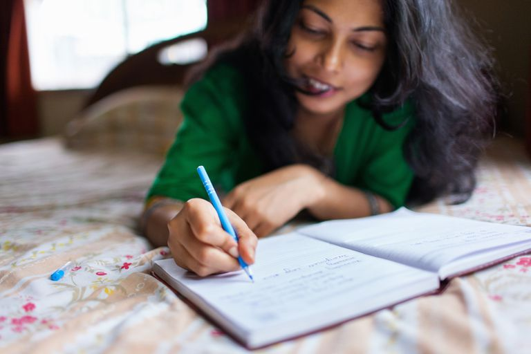 Woman writing in planner