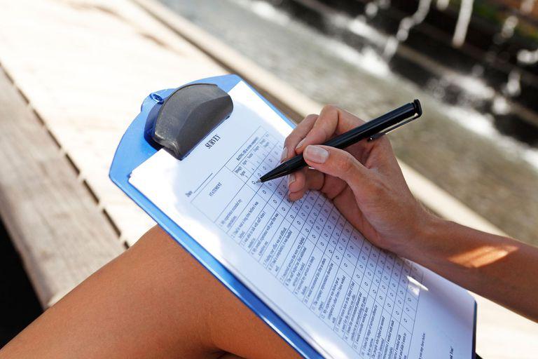 Woman filling out a survey form